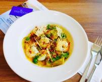 Handmade Pesto Ravioli with Fava Beans, Tiger Prawns & Crunchy Parmesan Leaves